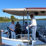 Todd discussing the tour with Capt. Jeff, Capt. Dan and Laura