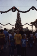 Family in Magic Kingdom at Christmas