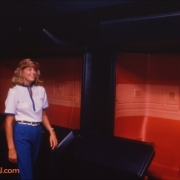 Horizons cast member in front of the ride vehicle/gondola