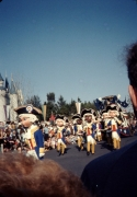 8ft tall characters with doll-like heads in America On Parade