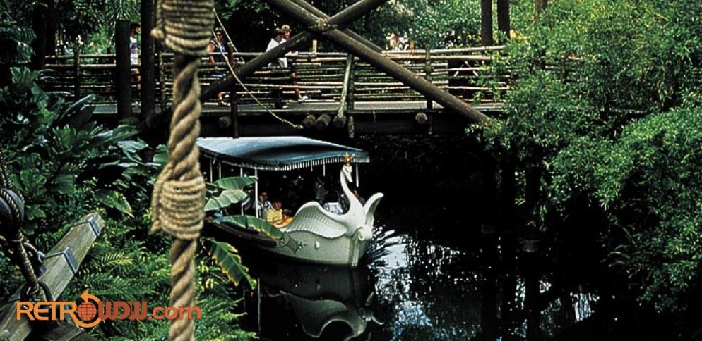 Swan Boat crossing under Adventureland Bridge