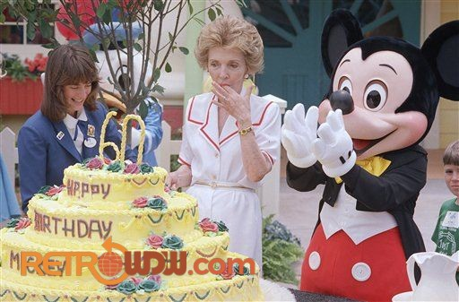 Nancy and Mickey celebrate in Mickey's Birthdayland