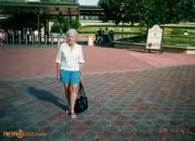 Photo of a woman outside the Magic Kingdom gates, November 25, 1994