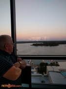 Tom Nabbe looking out the window at the top of the Contemporary Resort