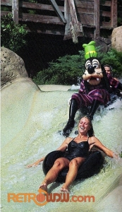 Goofy riding an inner tube on the White Water Rapids